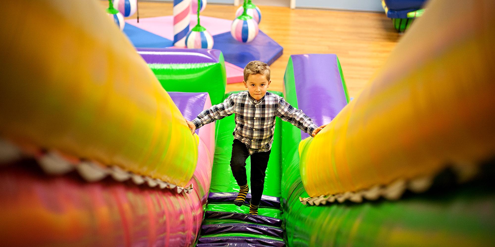 Lykkeland, a play centre in Steinkjer - boy ascending to the slide. Copyright: Lykkeland