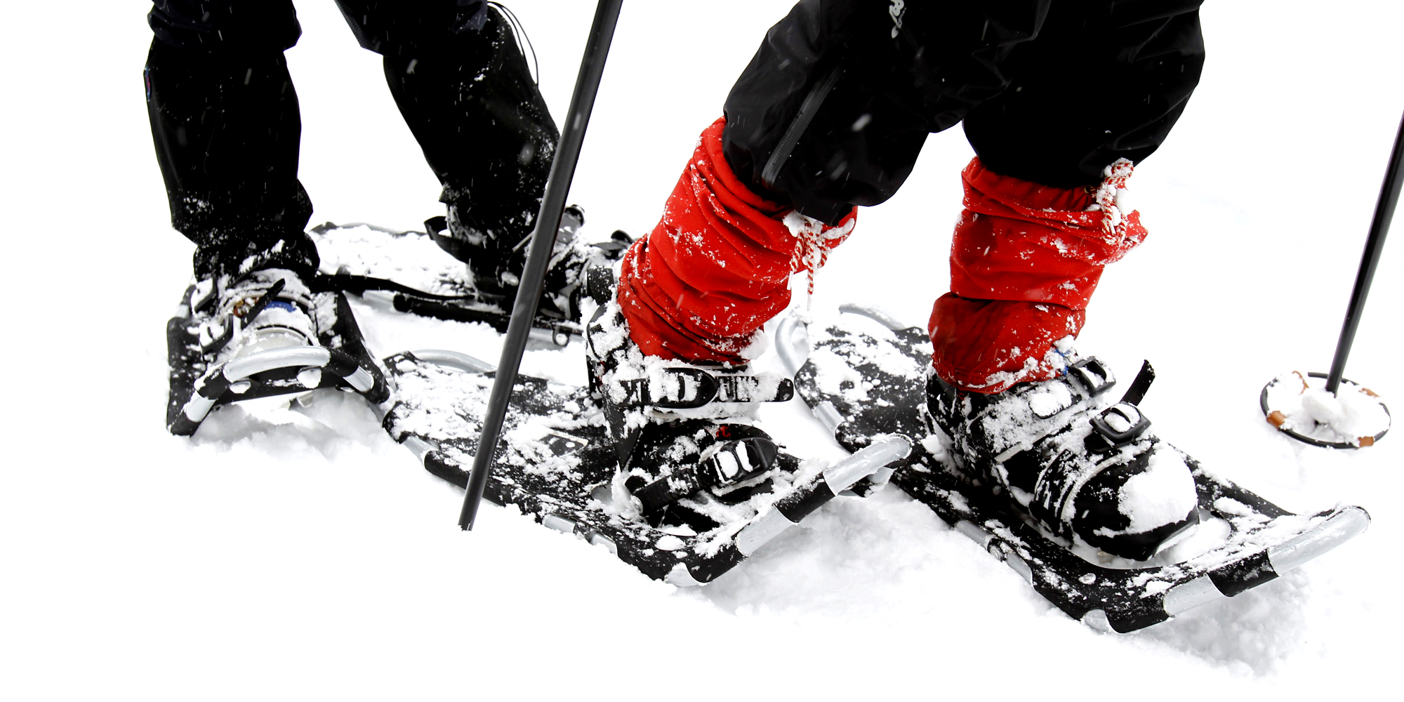 Snowshoeing at Mokk Farm - 2 pair snowshoe clad feet in the snow. Copyright: Mokk Gård - L A Holme