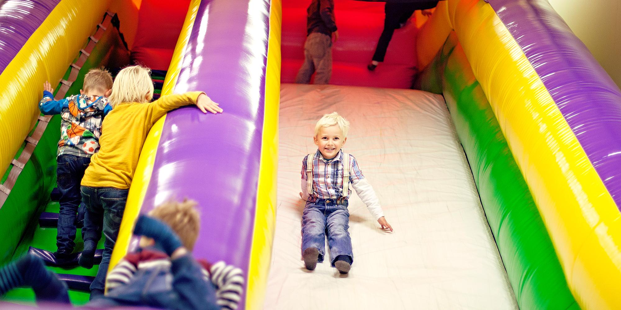 Lykkeland a play centre in Steinkjer - girl going down the slide. Copyright: Lykkeland