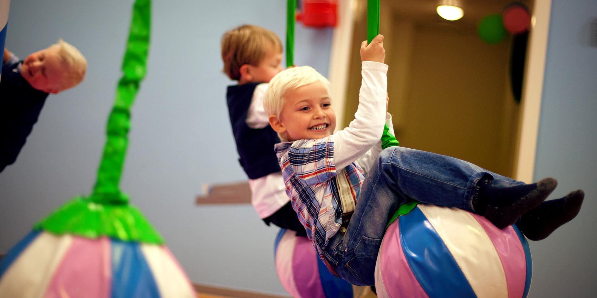 Lykkeland, a play centre in Steinkjer - girl on a hanging ball. Copyright: Lykkeland