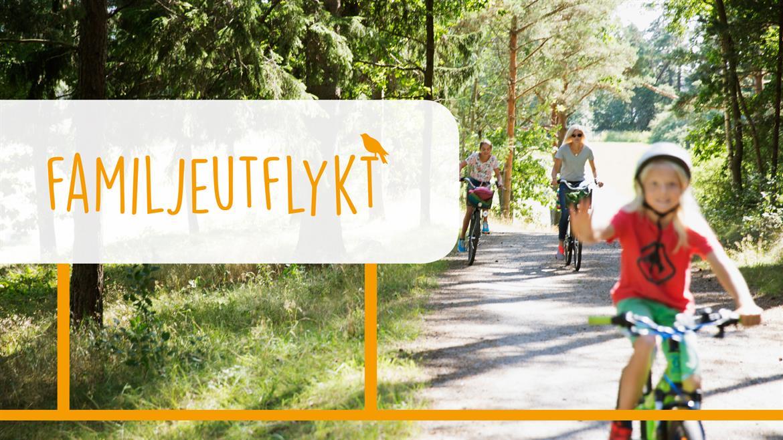 Familj ute på cykeltur