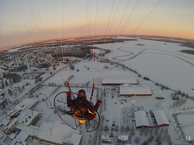 Paramotor over the ice arena