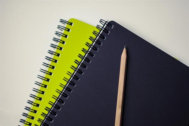Skrivböcker och en penna